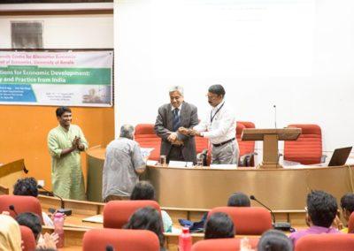 07 Prof. B S Chimni hand overing the reports to Prof. Satish K Jain