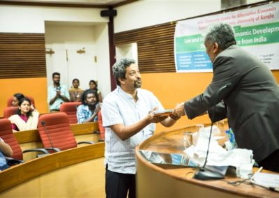 09 Prof. B S Chimni hand overing the reports to Prof. R Vijay